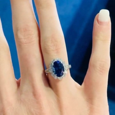 Oval Cut Blue Sapphire Sterling Silver Halo Engagement Ring