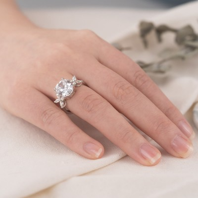 Flower Inspired Oval Cut White Sapphire Sterling Silver Engagement Ring
